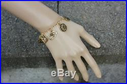 Deluxe Gold Ancient Religions Charm Bracelet -Buddha, Om, Hamsa hand, Angel wing
