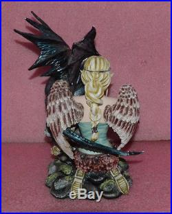 Large Blond Fairy With Angel Wings and Black Dragon Figurine
